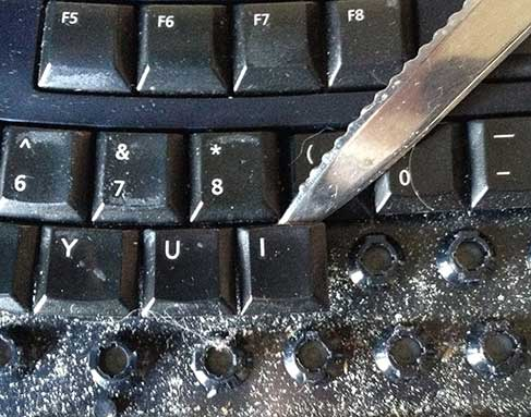 A letter opener or knife can be used to remove keys from a keyboard